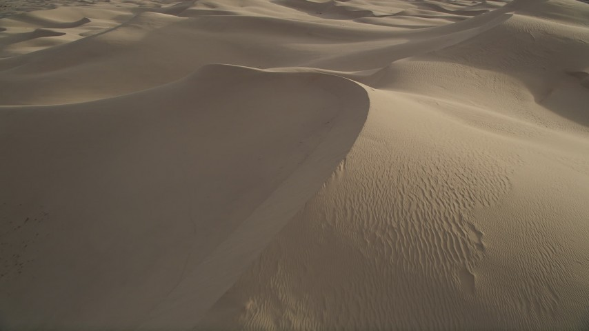 5K aerial video fly low over sand dunes, Kelso Dunes, Mojave Desert, California Aerial Stock Footage | AX0012_027