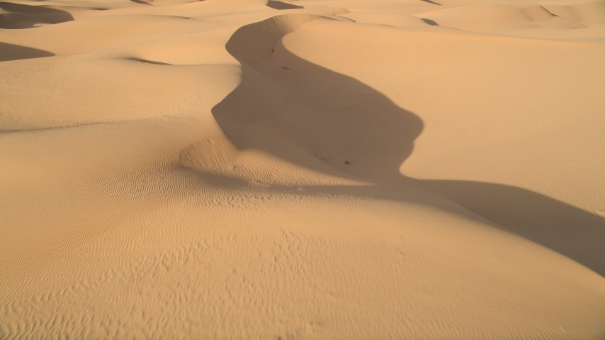 5K stock footage aerial video fly over sand dunes, Kelso Dunes, Mojave Desert, California Aerial Stock Footage   AX0012_032E