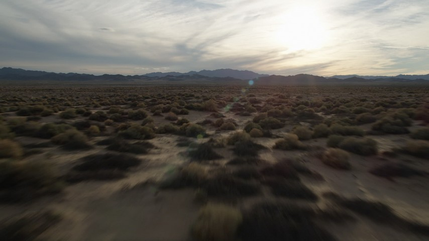 5K stock footage aerial video fly low over desert plain, Mojave Desert, California Aerial Stock Footage | AX0012_041
