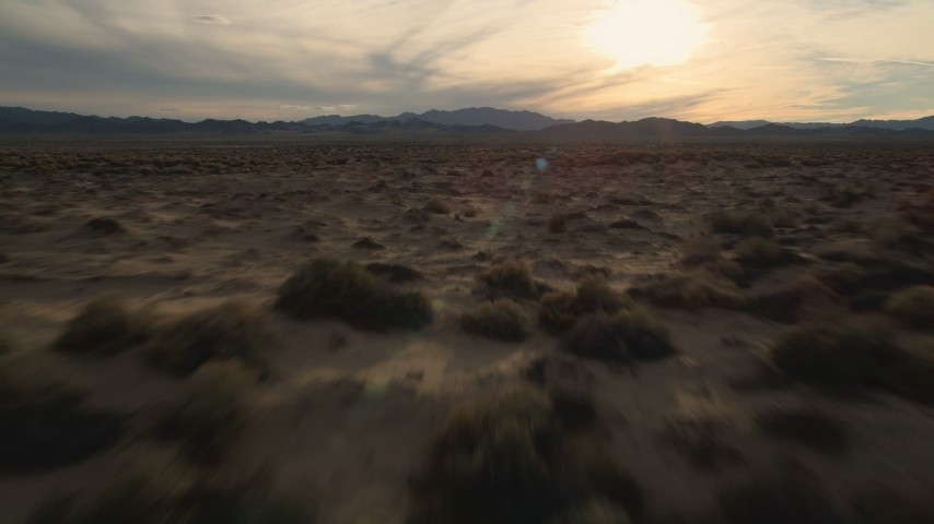 5K stock footage aerial video fly low over desert plain, Mojave Desert, California Aerial Stock Footage | AX0012_041E