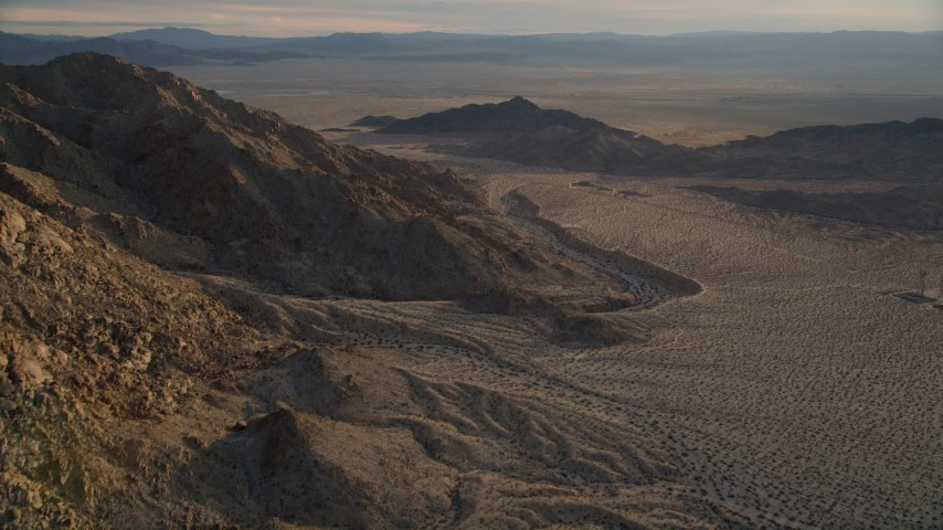 5K stock footage aerial video of mountain slopes and desert, Mojave Desert, California, sunset Aerial Stock Footage | AX0012_047