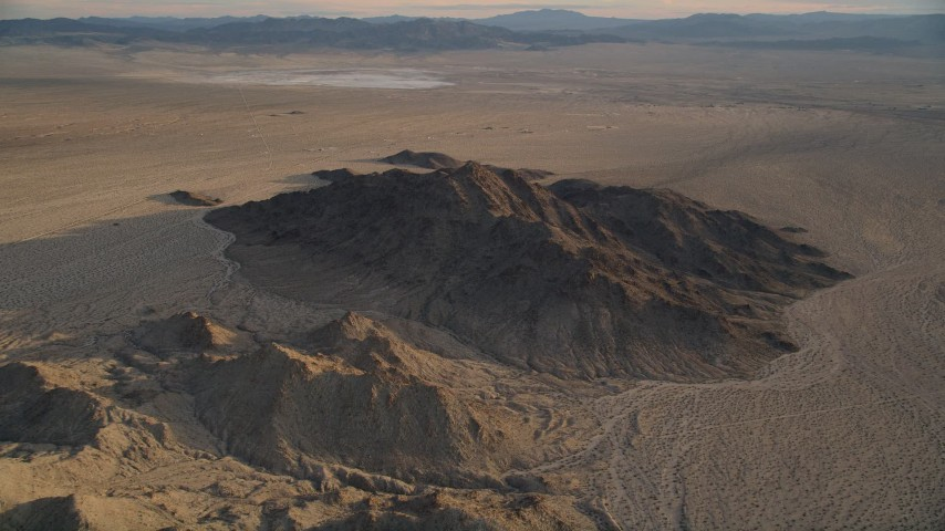 5K stock footage aerial video fly over desert mountains, Mojave Desert, California, sunset Aerial Stock Footage | AX0012_049