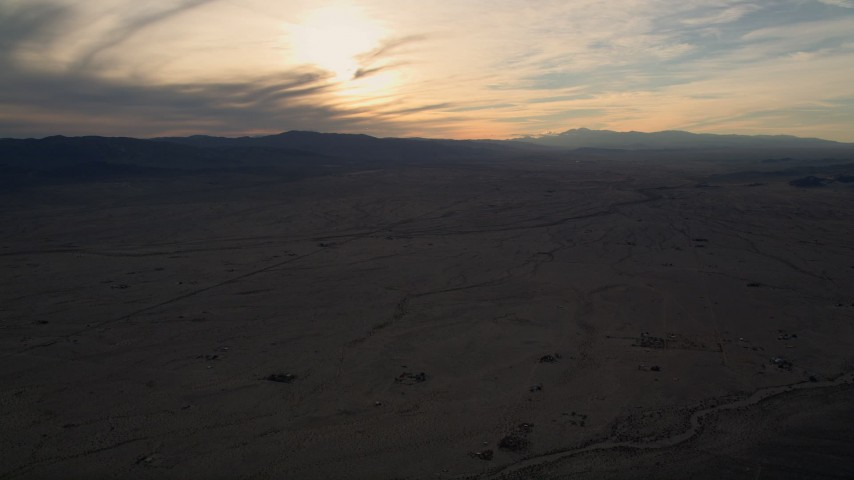 5K stock footage aerial video of a desert plain, Mojave Desert, California, sunset Aerial Stock Footage | AX0012_051