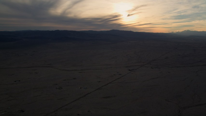 5K stock footage aerial video of Mojave Desert plain at sunset in California Aerial Stock Footage | AX0012_053