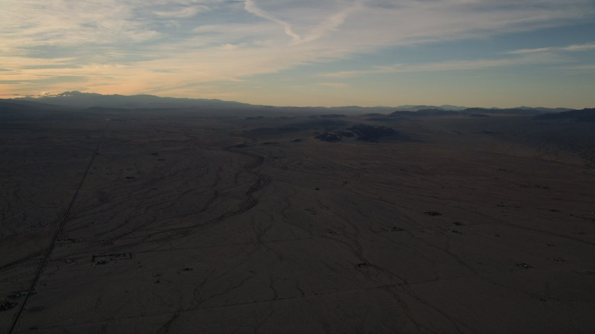 5K stock footage aerial video of a flat desert plain at sunset in the Mojave Desert, California Aerial Stock Footage | AX0012_055