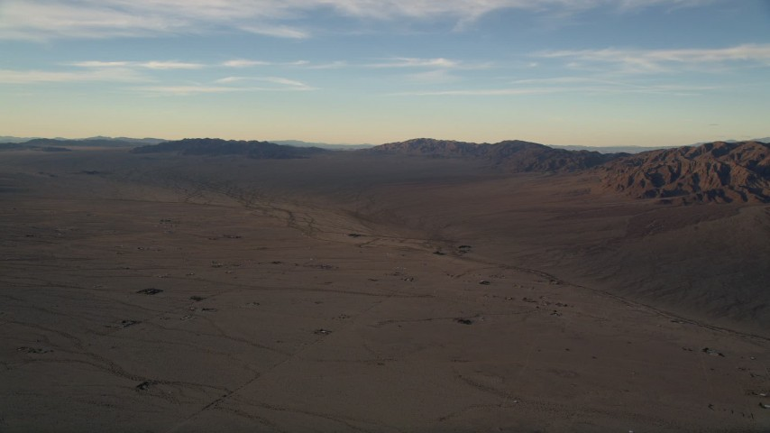 5K aerial video of desert plain and mountains at sunset, Mojave Desert, California Aerial Stock Footage   AX0012_056