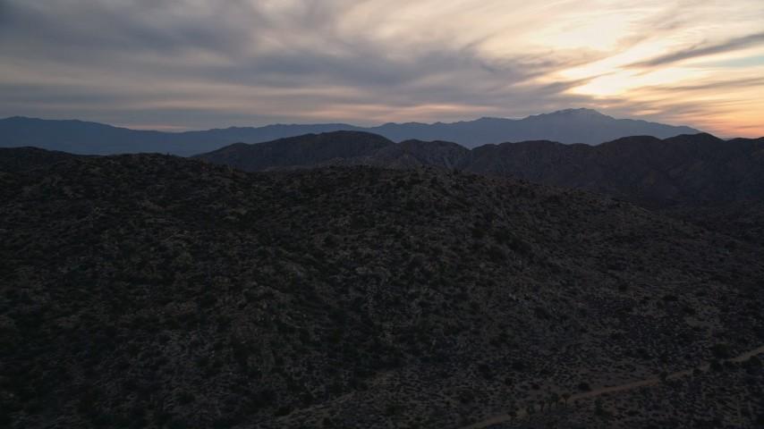 5K aerial video fly over desert mountains, Mojave Desert, California, sunset Aerial Stock Footage   AX0012_060