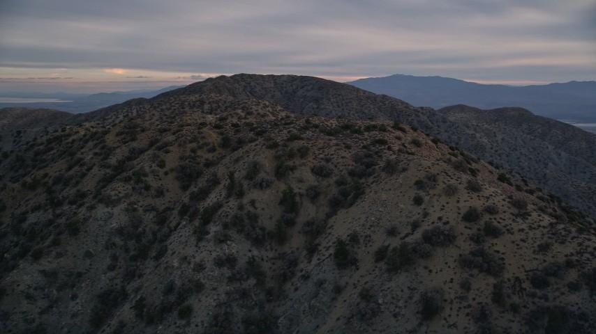 5K stock footage aerial video orbiting desert summit peaks, Mojave Desert, California Aerial Stock Footage | AX0012_061