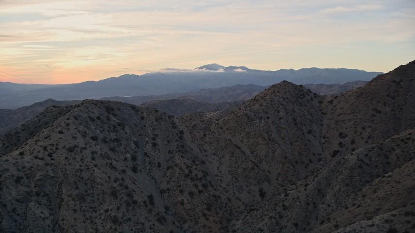 5K aerial video fly over desert mountains, Mojave Desert, California, sunset Aerial Stock Footage   AX0012_062