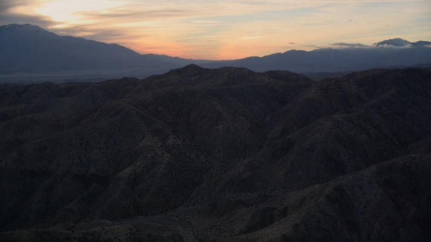 5K stock footage aerial video of the desert mountains, Mojave Desert, California, sunset Aerial Stock Footage | AX0012_064