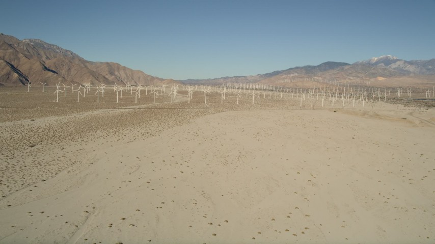 5K stock footage aerial video fly by windmills in the desert, San Gorgonio Pass Wind Farm, California Aerial Stock Footage | AX0013_002
