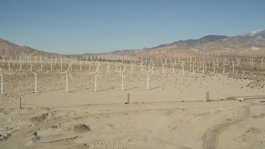 5K stock footage aerial video of a wind farm in the desert, San Gorgonio Pass Wind Farm, California Aerial Stock Footage   AX0013_004