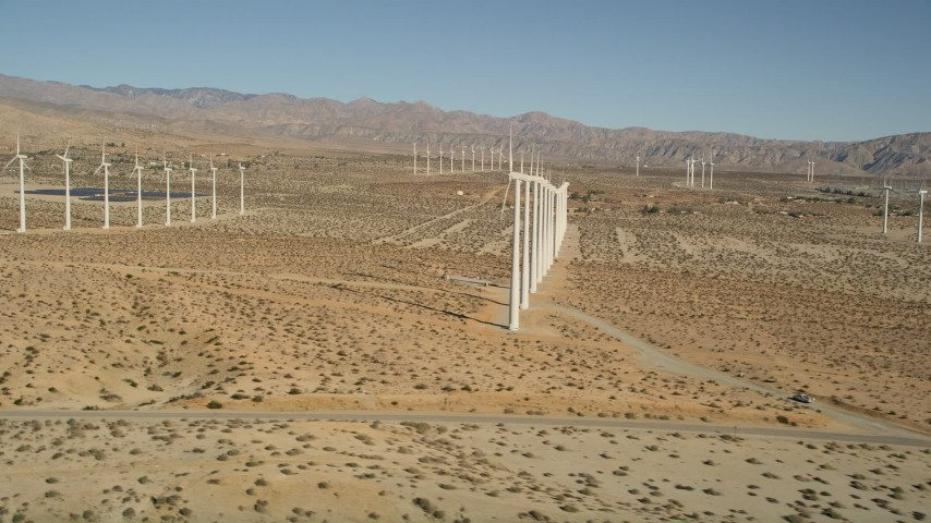 5K stock footage aerial video fly by windmills in the desert, San Gorgonio Pass Wind Farm, California Aerial Stock Footage | AX0013_013