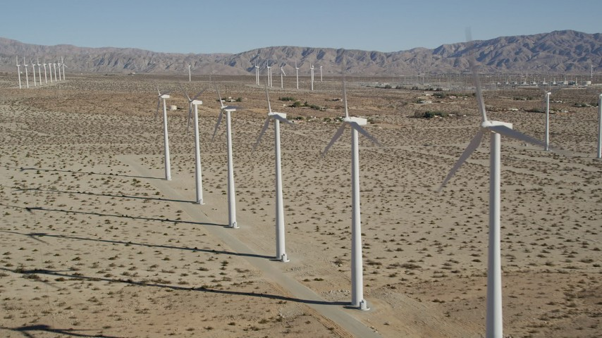 5K stock footage aerial video fly by rows of windmills, San Gorgonio Pass Wind Farm, California Aerial Stock Footage | AX0013_015