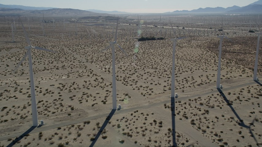 5K stock footage aerial video fly by rows of windmills, San Gorgonio Pass Wind Farm, California Aerial Stock Footage | AX0013_017