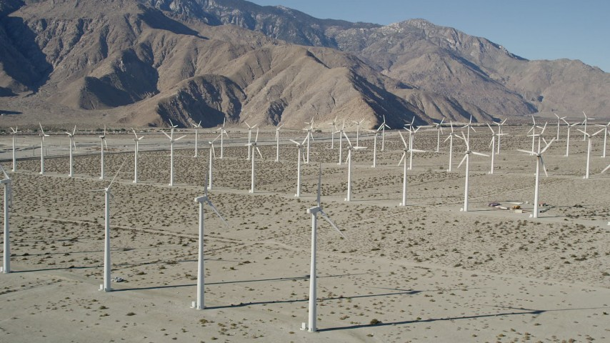 5K stock footage aerial video of flying by rows of windmills, San Gorgonio Pass Wind Farm, California Aerial Stock Footage | AX0013_020