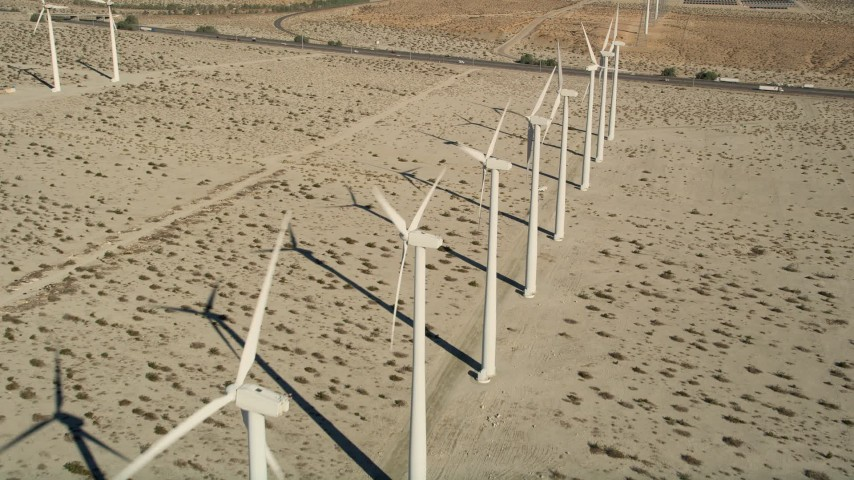 5K stock footage aerial video fly over a row of windmills, San Gorgonio Pass Wind Farm, California Aerial Stock Footage | AX0013_023
