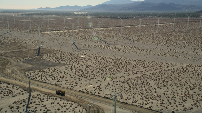 5K stock footage aerial video approach and fly over windmills, San Gorgonio Pass Wind Farm, California Aerial Stock Footage | AX0013_030
