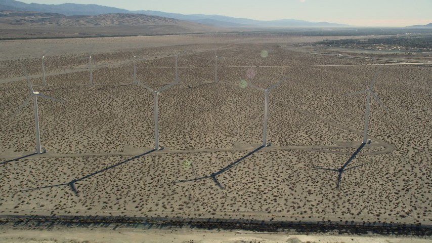 5K stock footage aerial video fly by windmills in the desert, San Gorgonio Pass Wind Farm, California Aerial Stock Footage | AX0013_031