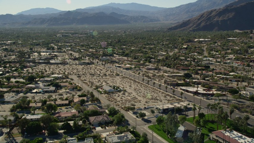 5K stock footage aerial video fly over apartment buildings toward residential road, Palm Springs, California Aerial Stock Footage | AX0013_033E