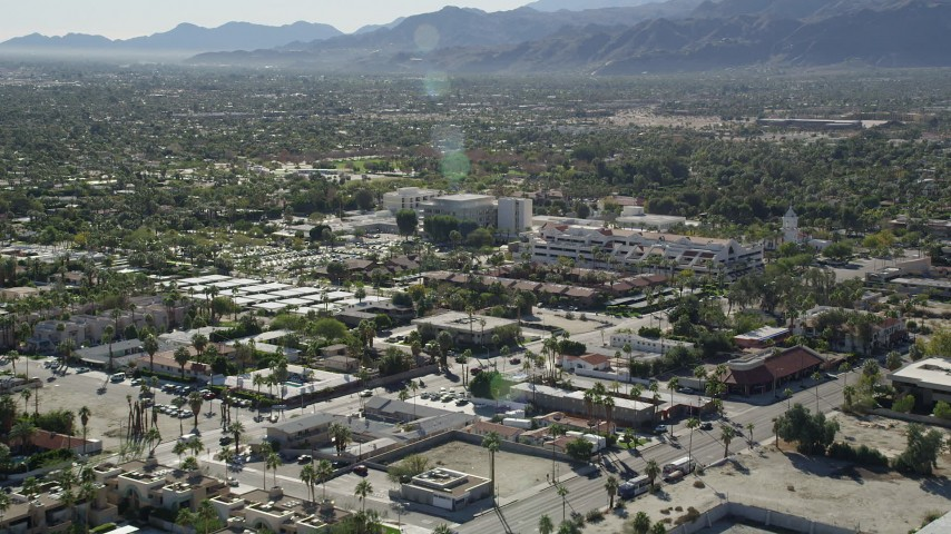 5K stock footage aerial video of approaching a medical center, West Palm Springs, California Aerial Stock Footage | AX0013_035
