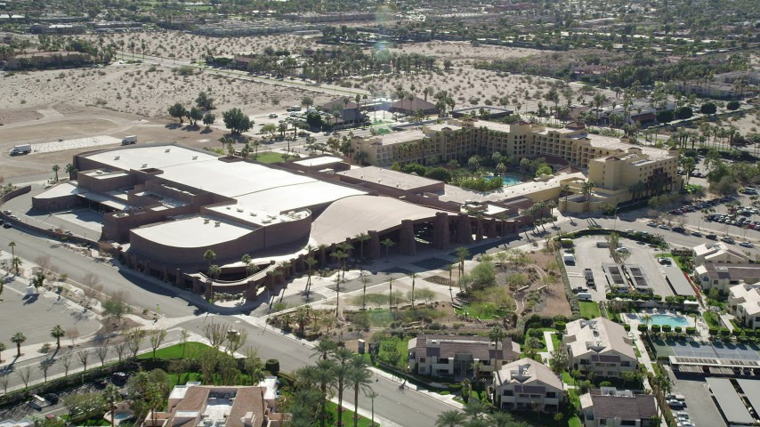 5K stock footage aerial video approach Palm Springs Convention Center, West Palm Springs, California Aerial Stock Footage | AX0013_038