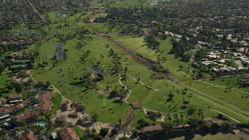 5K stock footage aerial video approach golf course, West Palm Springs, California Aerial Stock Footage AX0013_041 | Axiom Images