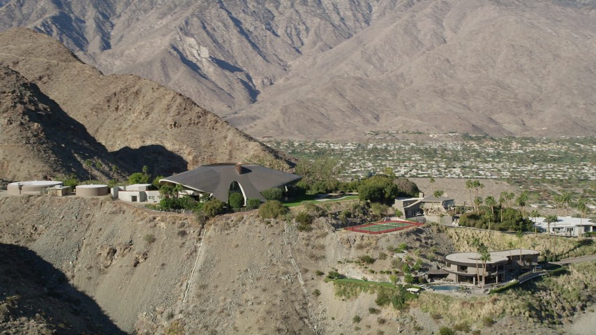 5K stock footage aerial video of flying away from a mansion in the hills, West Palm Springs, California Aerial Stock Footage | AX0013_052