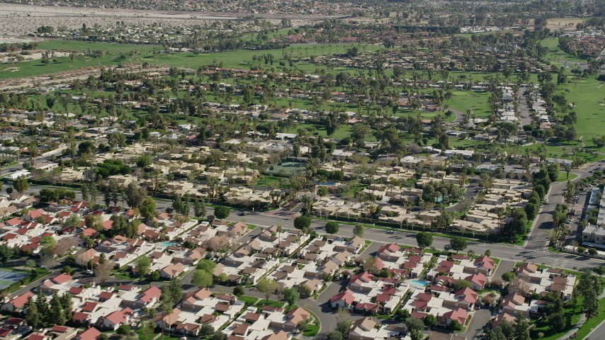 5K aerial stock footage video of residential neighborhoods and golf course, West Palm Springs, California Aerial Stock Footage | AX0013_053