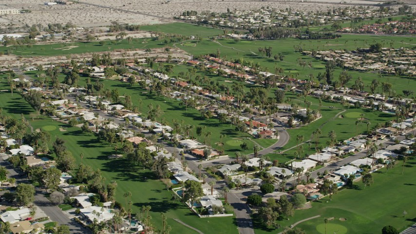 5K stock footage aerial video of residential neighborhoods along a golf course, West Palm Springs, California Aerial Stock Footage | AX0013_054