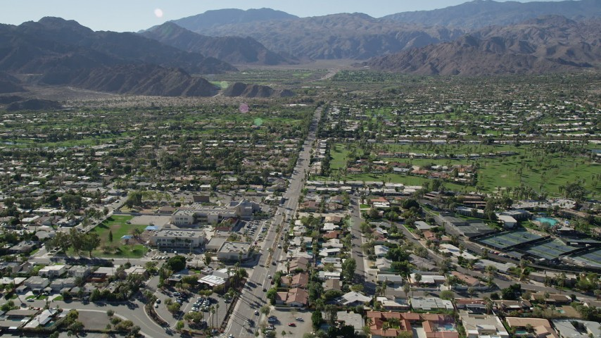 5K stock footage aerial video fly over residential neighborhoods toward mountains, Indian Wells, California Aerial Stock Footage | AX0013_074