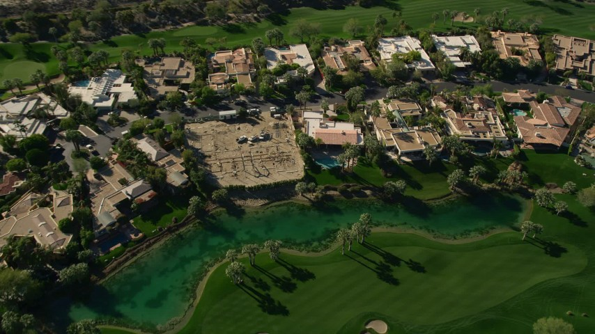 5K aerial stock footage video of upscale home along a golf course, Indian Wells, California Aerial Stock Footage   AX0013_076