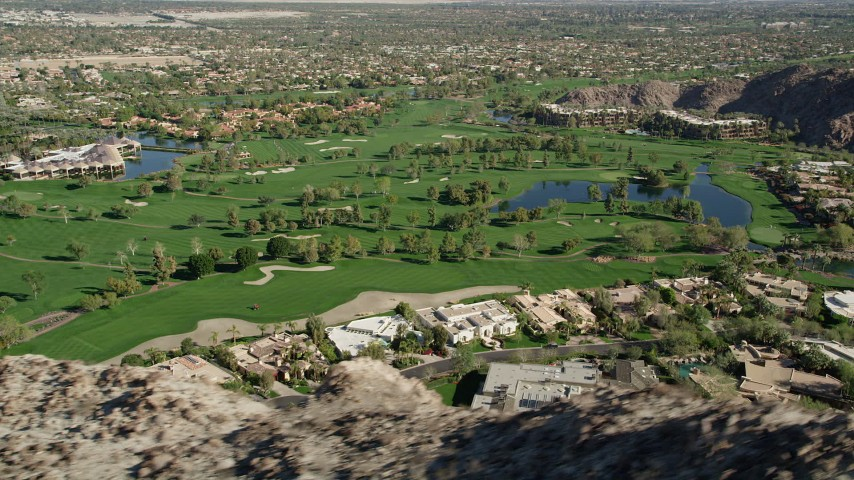 5K stock footage aerial video fly by golf course at the base of a mountain, Indian Wells, California Aerial Stock Footage | AX0013_079