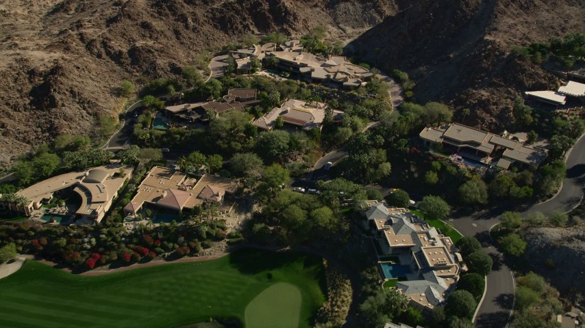 5K stock footage aerial video of mansions at the base of a mountain, Indian Wells, California Aerial Stock Footage | AX0013_080