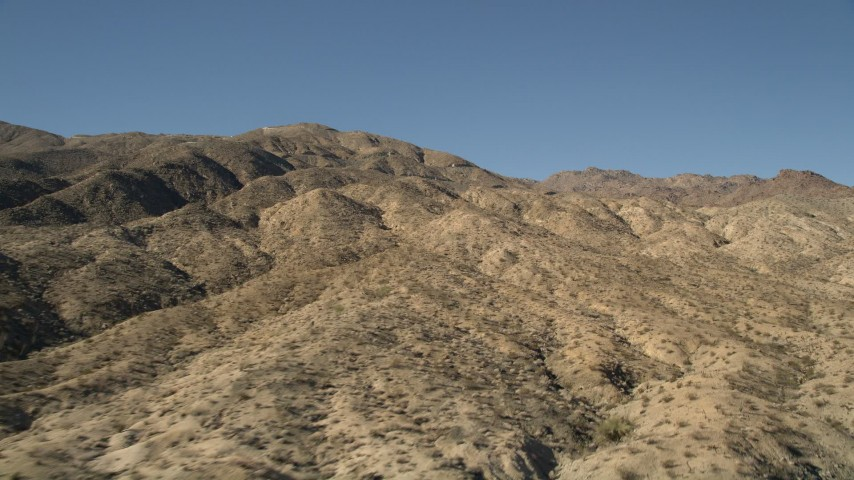 5K stock footage aerial video of flying up hills toward San Jacinto Mountains, California Aerial Stock Footage   AX0014_001