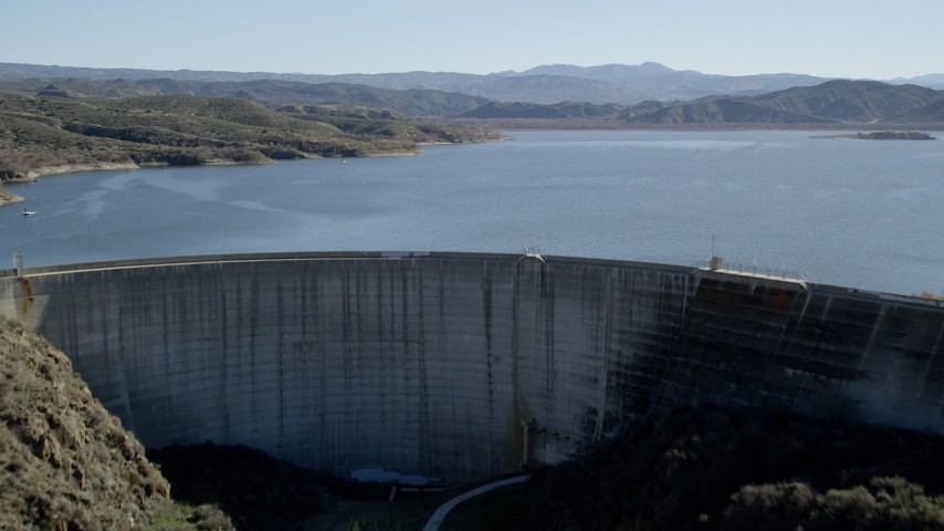 5K stock footage aerial video fly over Hemet Dam revealing Lake Hemet; California Aerial Stock Footage AX0014_030