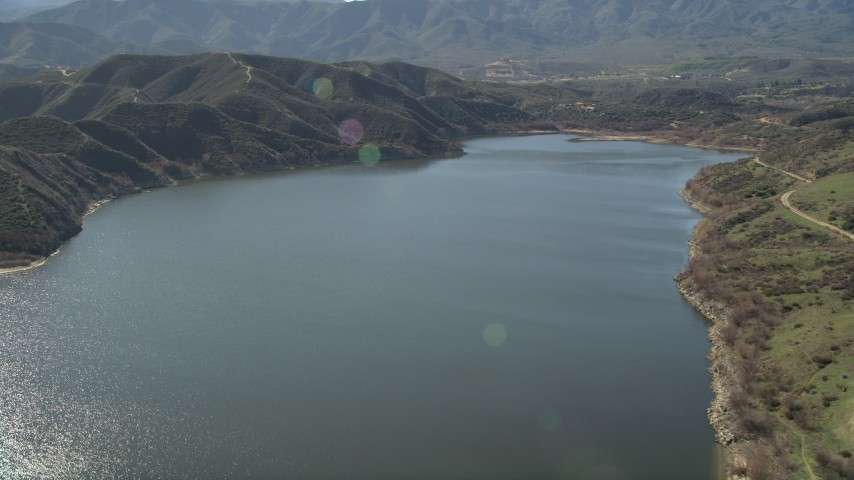 5K stock footage aerial video fly high over Lake Hemet, California Aerial Stock Footage | AX0014_031