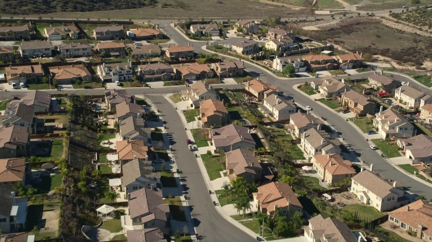 5K stock footage aerial video approach residential neighborhood and tract homes, Temecula, California Aerial Stock Footage | AX0014_036