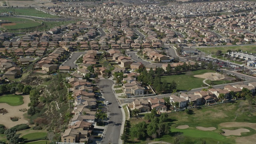 5K stock footage aerial video fly low over tract homes in residential neighborhoods, Temecula, California Aerial Stock Footage | AX0014_039