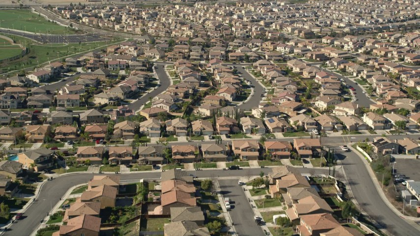 5K stock footage aerial video fly low over tract homes in residential neighborhoods, Temecula, California Aerial Stock Footage | AX0014_039E