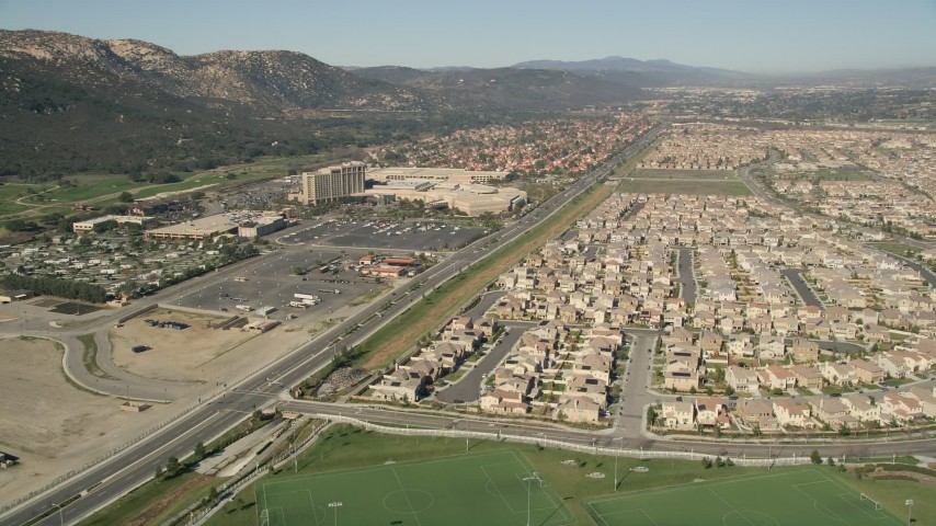 5K stock footage aerial video of Pechanga Resort and Casino near residential neighborhoods, Temecula, California Aerial Stock Footage | AX0014_047