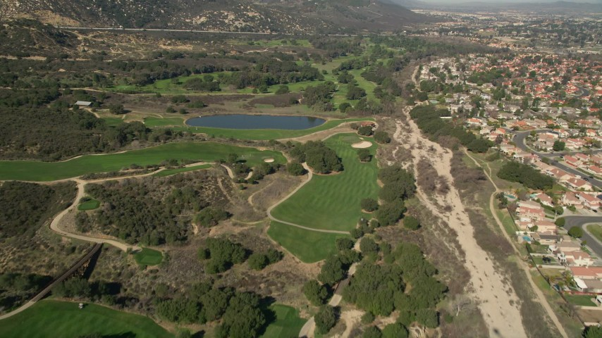 5K stock footage aerial video of flying over a golf course, Temecula, California Aerial Stock Footage | AX0014_050