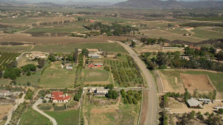 5K aerial video fly over rural homes and vineyards, Temecula, California Aerial Stock Footage | AX0014_056