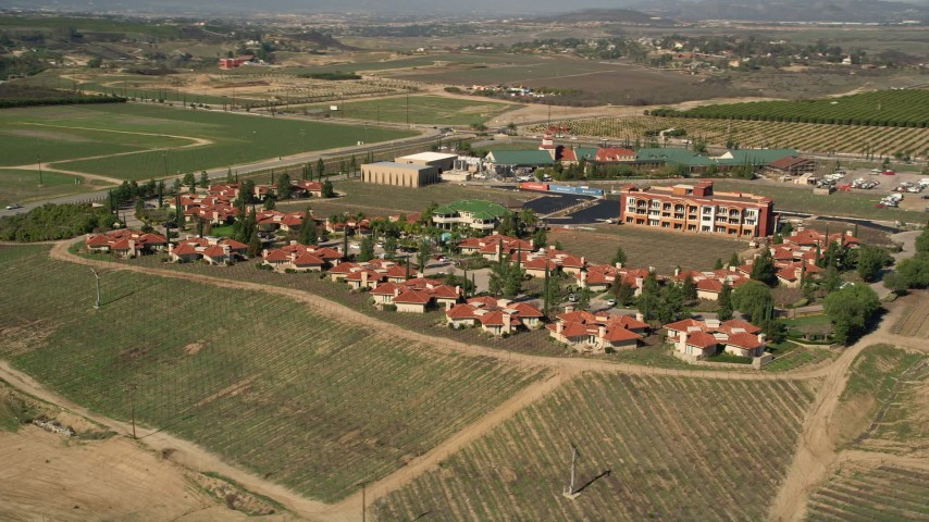 5K stock footage aerial video orbiting a resort among vineyards, Temecula, California Aerial Stock Footage | AX0014_064