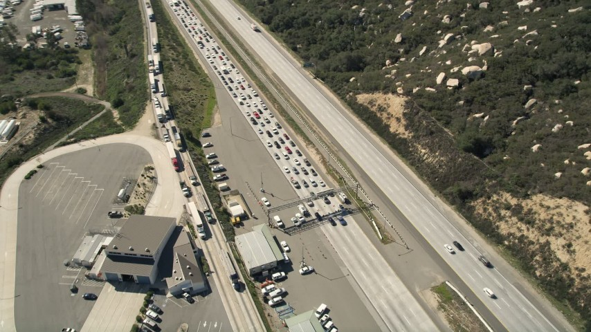 5K stock footage aerial video approach and orbit highway inspection facility beside the freeway, Temecula, California Aerial Stock Footage | AX0015_004E
