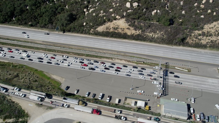 5K aerial video of orbiting heavy traffic at an inspection facility, Temecula, California Aerial Stock Footage | AX0015_005