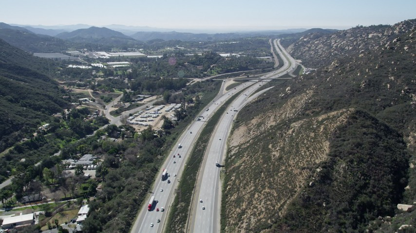 5K stock footage aerial video follow light traffic on an interstate through hills, Temecula, California Aerial Stock Footage | AX0015_006