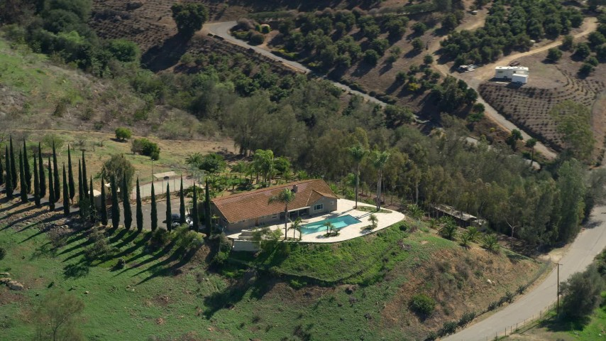 5K stock footage aerial video of orbiting hilltop house, Fallbrook, California Aerial Stock Footage | AX0015_021