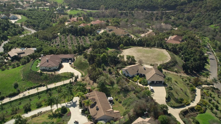5K stock footage aerial video fly by large homes in the hills, Fallbrook, California Aerial Stock Footage | AX0015_025