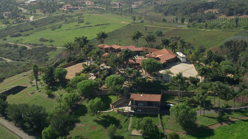 5K stock footage aerial video approach a large house atop a hill, Fallbrook, California Aerial Stock Footage | AX0015_028E